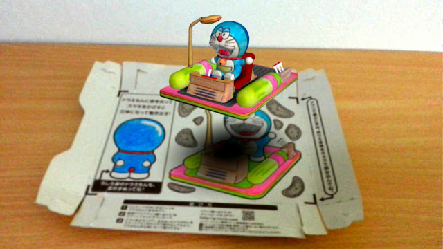 http://en.rocketnews24.com/2014/07/14/japans-glico-lets-snackers-turn-their-empty-boxes-into-augmented-reality-sets-for-doraemon/