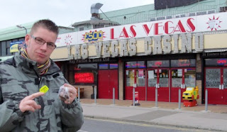 Photo: Richard Gottfried outside the Las Vegas Casino in Canvey Island. He won one token from the 2p pusher