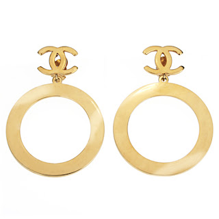 "Vintage 1970's gold Chanel hoop dangling earrings with ""CC"" logo."