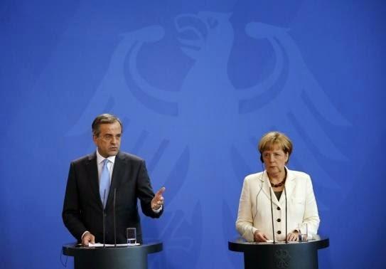 Ο Έλληνας Πρωθυπουργός Αντώνης Σαμαράς και η Γερμανίδα καγκελάριος Άνγκελα Μέρκελ δίνουν κοινή συνέντευξη Τύπου στο Βερολίνο στις 23 Σεπτεμβρίου του 2014.