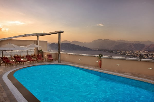 Relax at Nour Arjaan by Rotana's rooftop temperature-controlled swimming pool, sauna and steam rooms