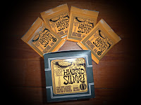 http://www.ernieball.com/products/electric-guitar-strings/1658/hybrid-slinky-nickel-wound