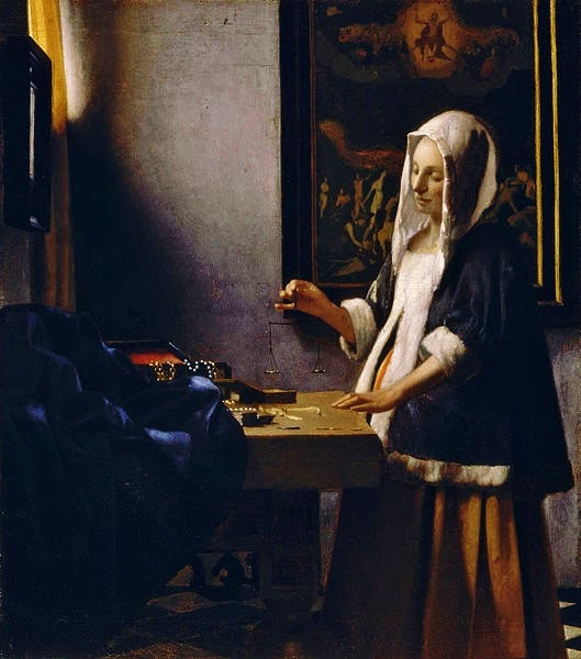 Woman Holding a Balance By Johannes VermeerVermeer Woman Holding A Balance