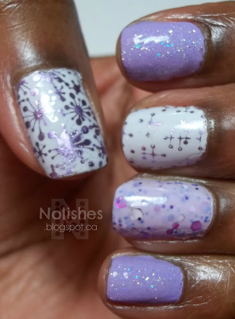 Manicure featuring multiple shades and finishes of purple nail polish, and an off-white crème polish embellished with a nail stamping design.