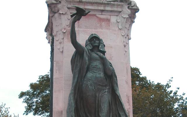 Statue of Peace on war memorial in Burton.