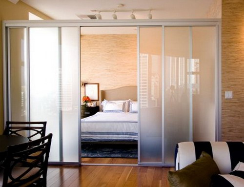 Sliding panel room divider studio apartment design