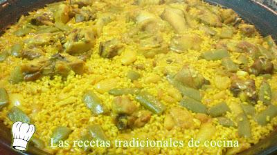 Paella Valenciana con pollo conejo y costillas