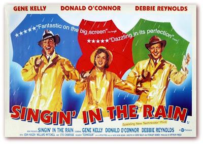 "Imagem do cartaz promocional do filme ""Cantando na Chuva"" (Singin' In The Rain)"