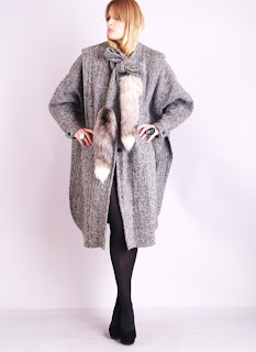 Vintage 1980's brown tweed coat with white fox tail tie front closure.