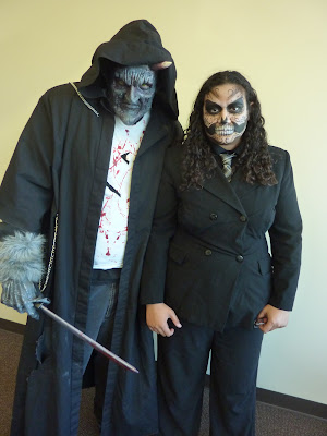 Man and woman posing in Scary Costumes for halloween
