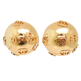 "Vintage 1990's gold ball Chanel earrings with ""CC"" logo pattern."