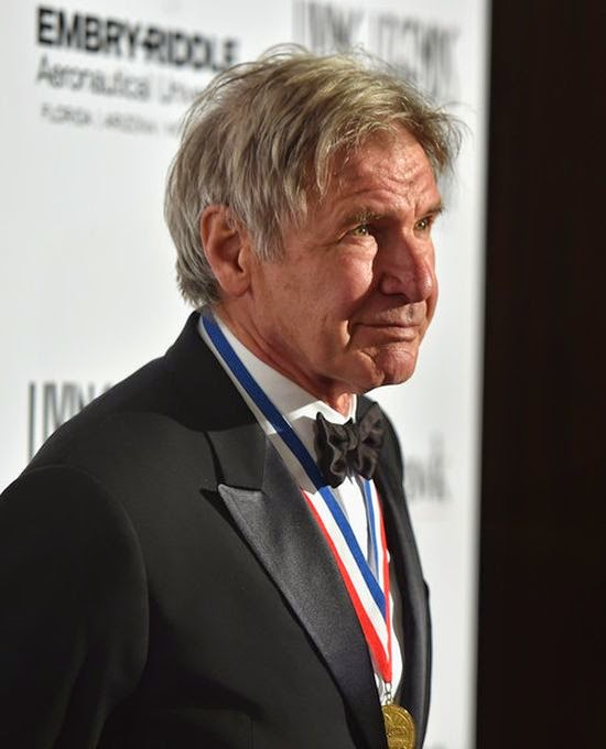 As the greatest actors of Hollywood do, John Travolta and Harrison Ford had a grand idea to get everyone talking about aircraft during the Living Legend Aviation Awards. The tanned and toned old man arrived to the Beverly Hilton Hotel at Beverly Hills on Friday, January 16, 2015, then ready to party.