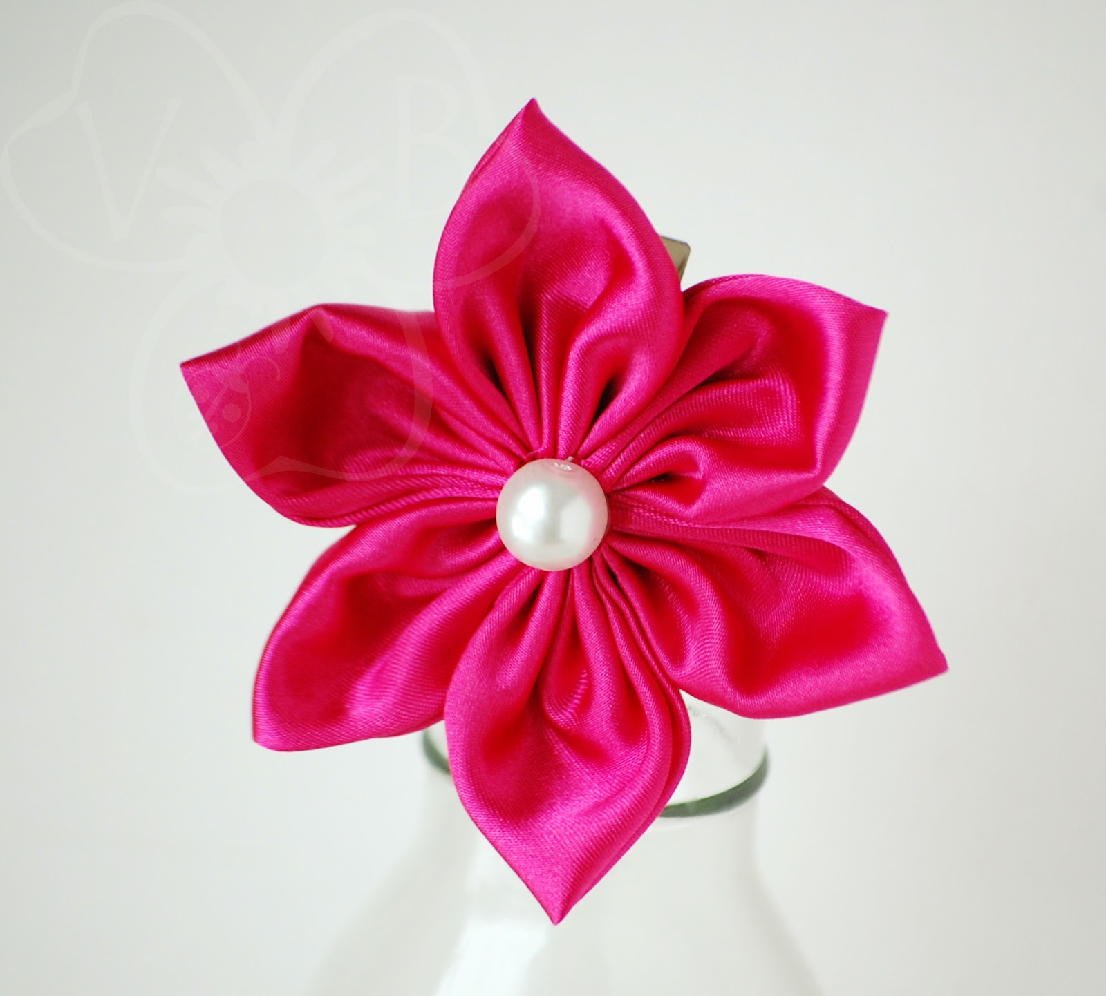 http://violetsbuds.storenvy.com/collections/220228-kanzashi-flowers/products/5551336-shiny-pomegranate-kanzashi-flower-clip