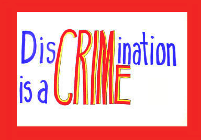 A handwritten sign that says discrimination is a crime.