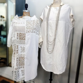 Lovely little mini white dresses from Robin Richman.