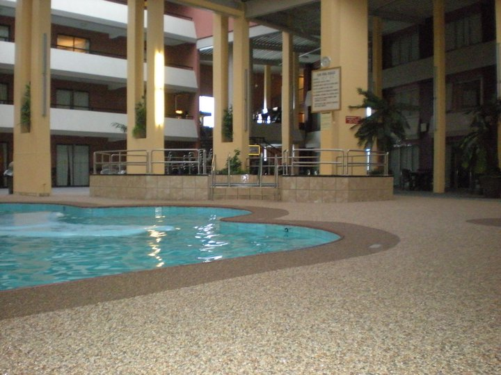Rustic terrazzo coatings resurfacing overlays exposed for Swimming pool floor
