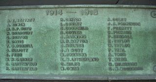 Greeny bronze plaque with raised names, listed in text below.