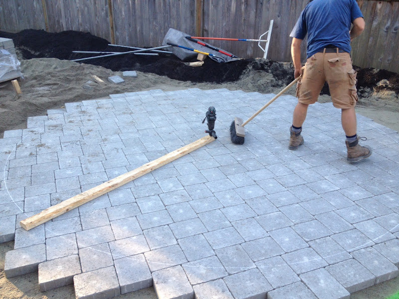 First, The Pavers Are Laid Beyond The Desired Circle To Hold Everything  Together During The Cutting Process. A 2x4, Cut To A Few Inches Longer Than  The ...