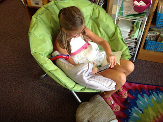 Independent reading in our reading nook, photo for The Schroeder Page, Back to School