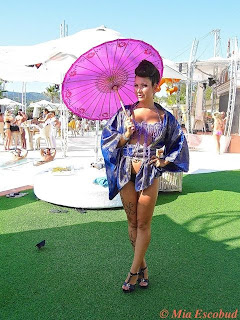Model with Parasol at Ocean Beach Ibiza
