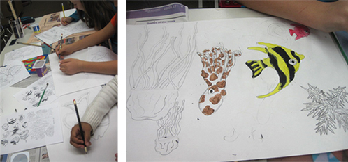 Students Paint Fish for Bulletin Board