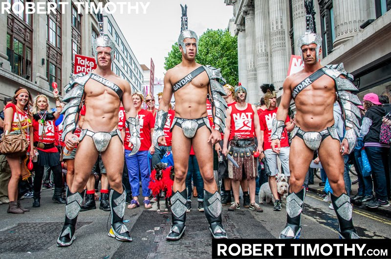 Three muscular guys dressed as Gladiators participating in the 2012 World Gay Pride Parade through Central London