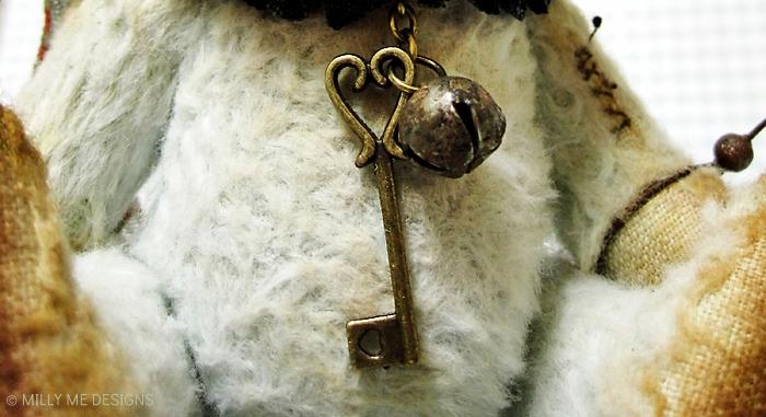 viscose clown teddy bear, heart key, rusty bell