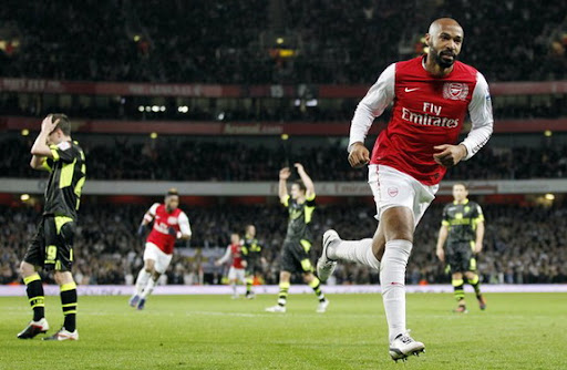 Thierry Henry celebrates after scoring for Arsenal against Leeds in the FA Cup