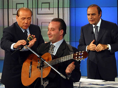 Silvio Berlusconi, Mariano Apicella, Bruno Vespa, on a TV show