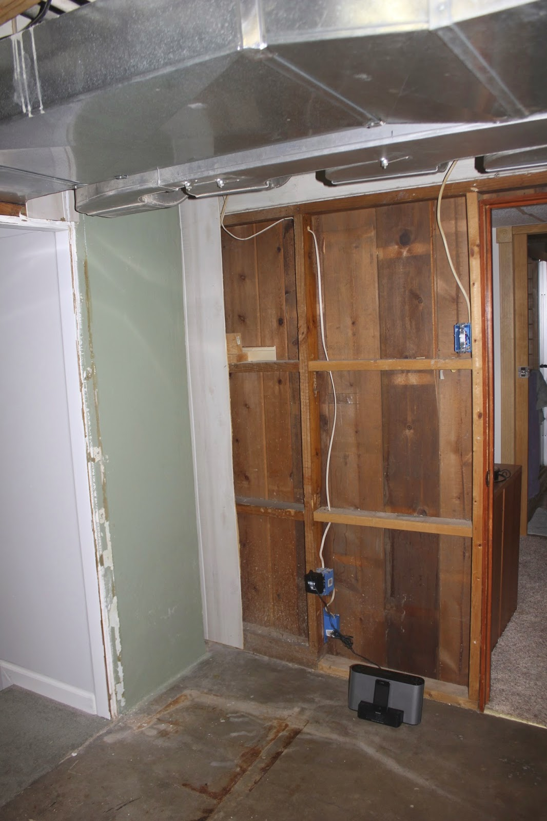 looking back toward the entrance to the finished part of the basement