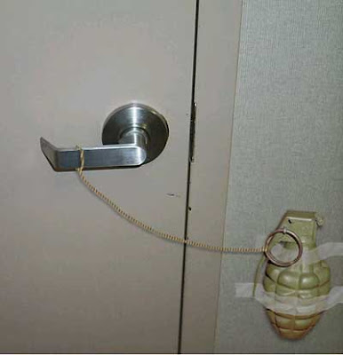 grenade attached to door handle booby trap explosive pictures