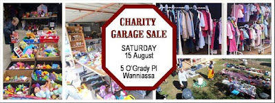Banner advertising the August Charity Garage Sale.