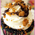 Dark Chocolate Cupcakes filled with Speculoos Spread and topped with Whipped Cream Frosting