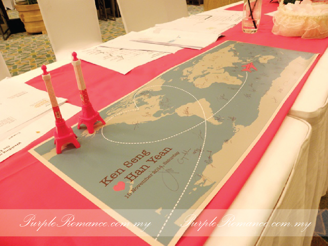 Photo Booth Backdrop Decoration, eiffel tower, guest book, travel around the world theme, wedding, reception table, wooden signage with country names, green carpet, green grass balls, wedding poster, welcome board with country passport stamps, initial, london bags, white fences, aeroplane, cute, clouds, Kuala lumpur, mandarin oriental hotel, selangor