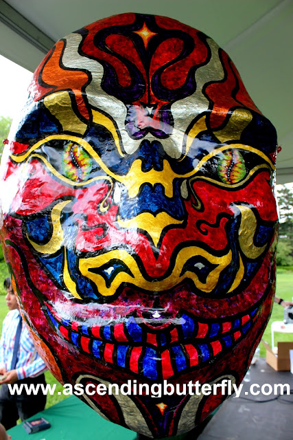 "7 ft tall paper mache sculpture entitled ""Quetzalcoatl"" (inspired by the Aztec deity and creator of mankind, and coming from the Nahuatl language meaning ""Feathered serpent"")"