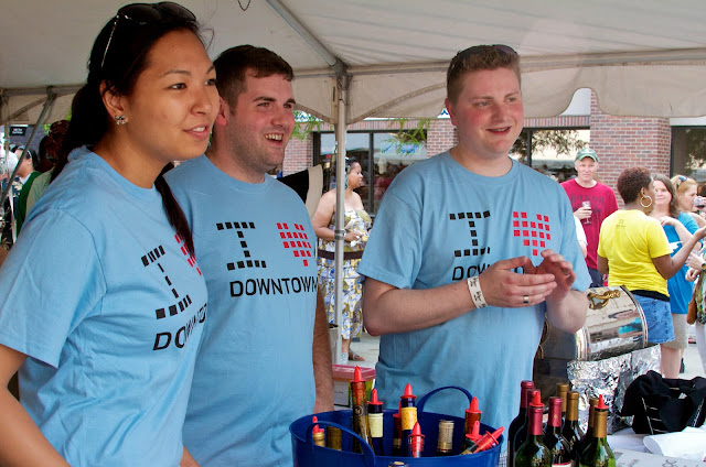 Taste of Downtown in Lansing, Michigan. Volunteers serve wine samples.
