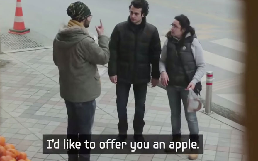 Entire Neighbourhood Secretly Learns Sign Language To Surprise Deaf Neighbor - …He offers them each an apple - in sign language