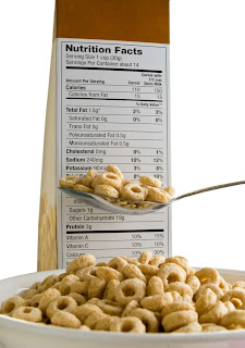 bowl of cereal and cereal box with Nutrition Facts label