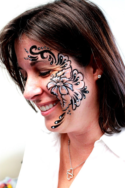 black and white line work face paint, flower pattern, elegant face paint