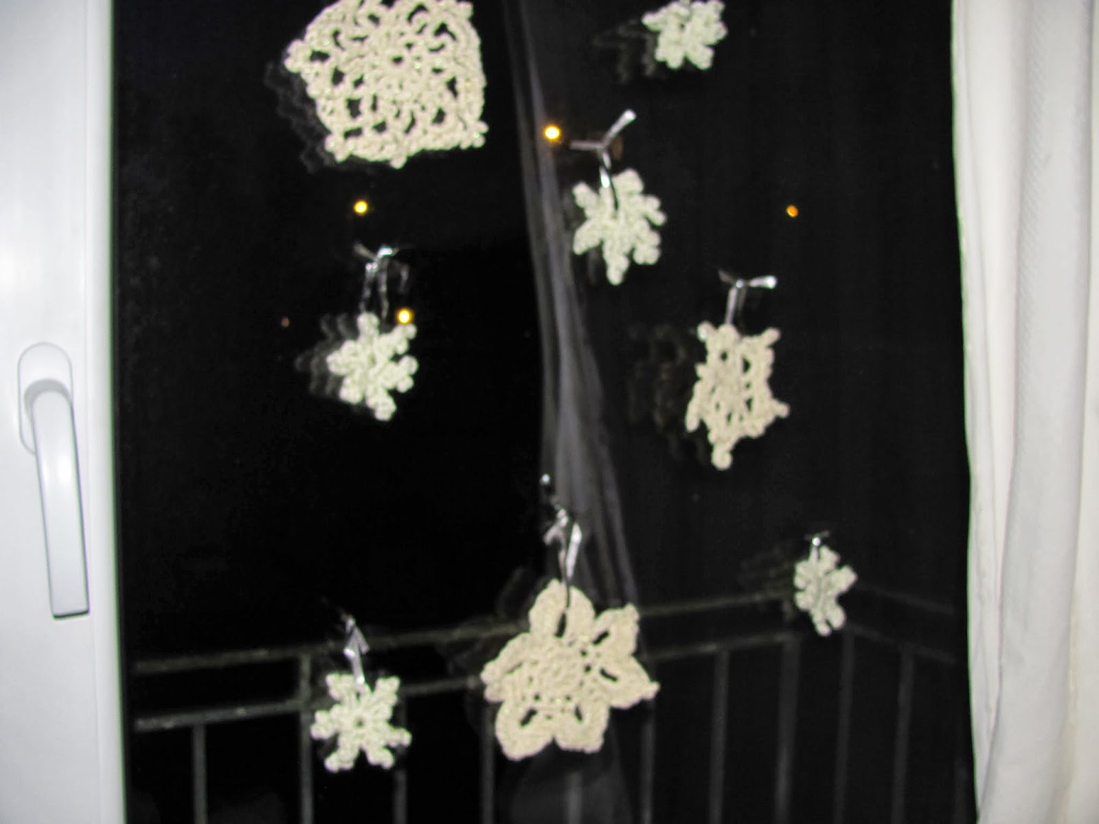 Snowflake decorations hanging in the window