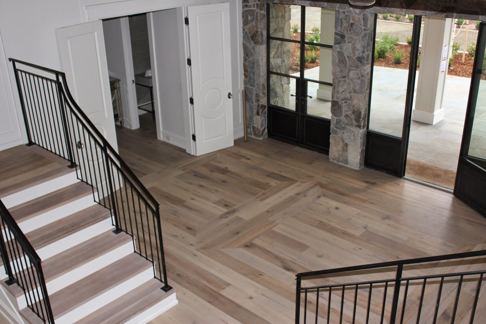 The Double Staircase Was Designed To Match The Floor Perfectly. The  Hardwood Entry Has A Unique Design That You Can See ...