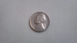 five cent nickle piece of money