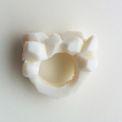A carved ivory soap ring.