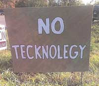 Brown Sign says No Technology, Technology is spelled wrong