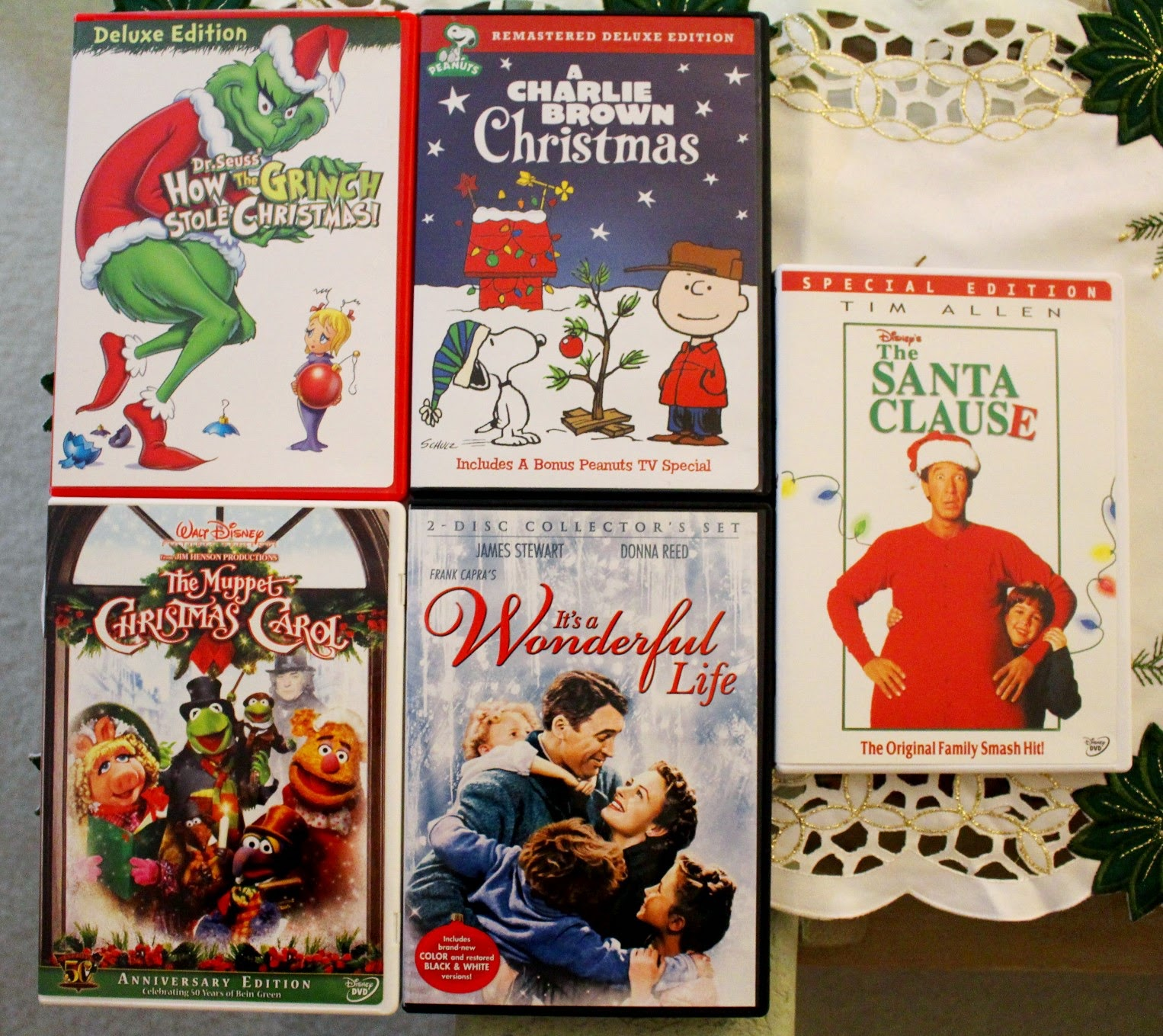 Covers of 5 Christmas movies- The Grinch, Charlie Brown, Muppet Christmas Carol, Its a Wonderful Life, Santa Clause