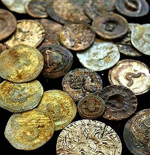http://christinemariedavis.com/Jewelry/ButtonJewelry/SmashedButtons.html