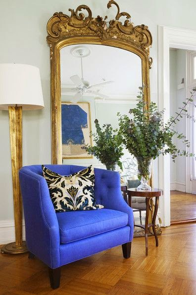 white living room with pop of bright blue color and gold