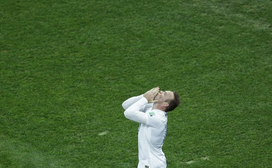 England's Wayne Rooney celebrates scoring his side's first goal during the group D World Cup soccer match between Uruguay and England at the Itaquerao Stadium in Sao Paulo, Brazil, Thursday, June 19, 2014.
