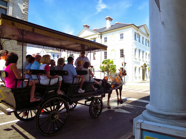 Tourists on a horse drawn carriage in Charleston, South Carolina