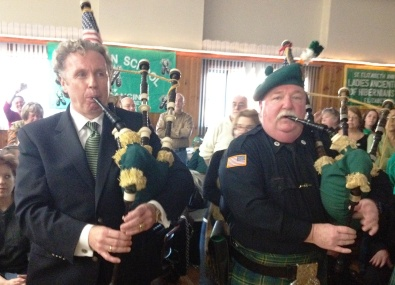 Union County St. Patrick's Day Parade Grand Marshal  Jim Tansey (left) plays the pipes